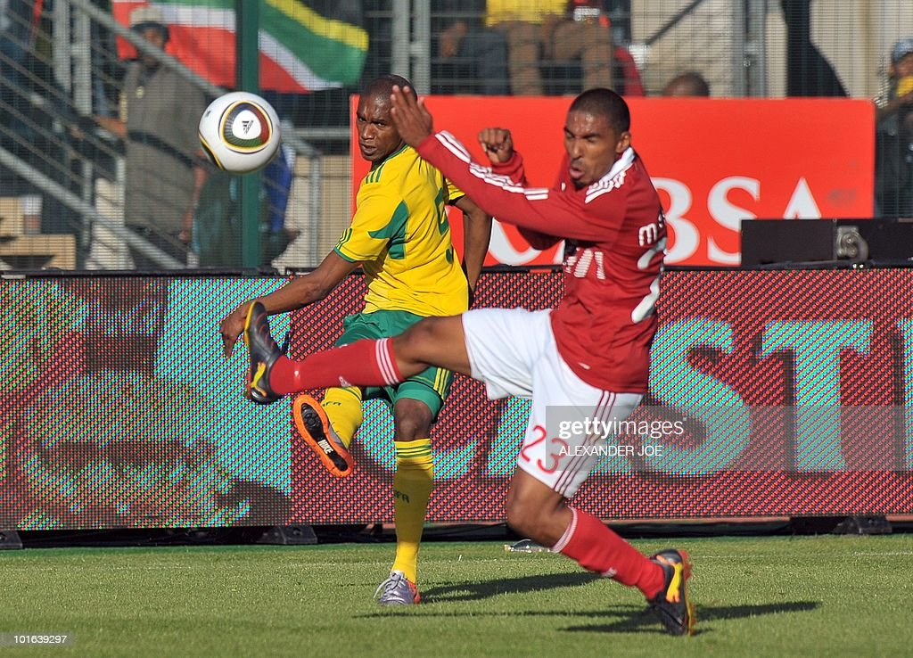 South African national football team striker Katlego Mphela (L) fights for the ball with Denmark's defender Patrick Mtiliga during their friendly match at Super Stadium in Pretoria on June 5, 2010 ahead of the FIFA 2010 World Cup in South Africa.