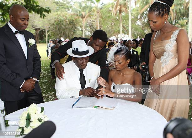 South African National Police Commissioner Bheki Cele and his new wife Thembeka Ngcobo sign the wedding register at their wedding held at the elite...