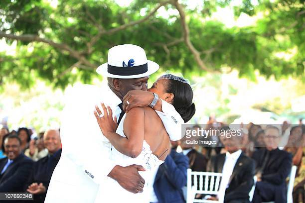 South African National Police Commissioner Bheki Cele kisses his new wife Thembeka Ngcobo at their wedding held at the elite Lynton Hall Estate on...