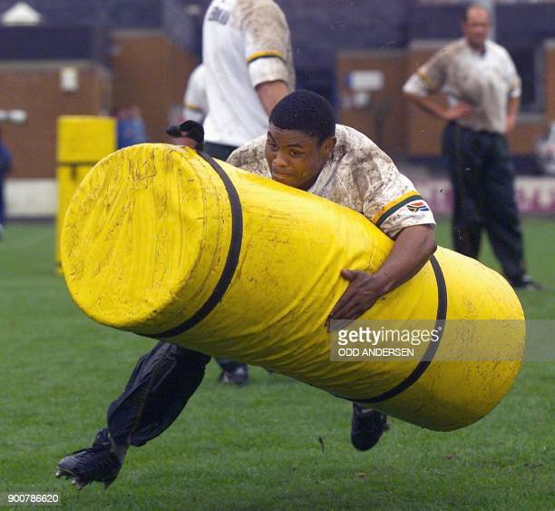 South African national rugby player Kaya Malotana attacks a dummy during a training session at the Old Anniesland rugby stadium in Glasgow 14 October...
