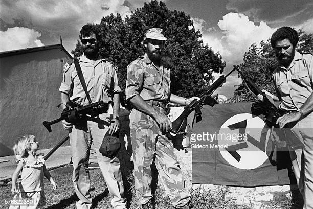 south african neo-nazis with guns - nazi flag stock pictures, royalty-free photos & images