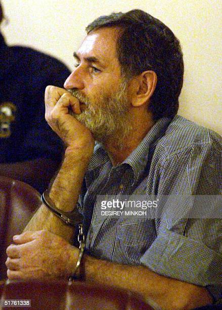 South African Nick du Toit, the chief accused, is pictured handcuffed at Congress Palace in Malabo, 18 November 2004, during a resumption of a trial...