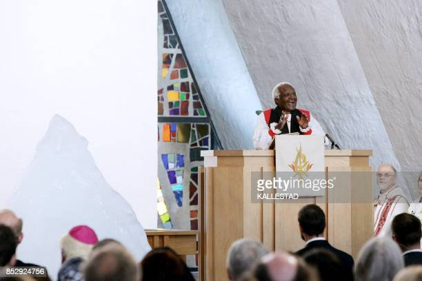 South African Nobel Peace Prize laureate Desmond Tutu holds 03 June 2007 a religious service in the Tromsoe Cathedral northern Norway ahead of the...