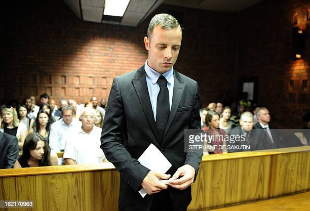 South African Olympic sprinter Oscar Pistorius appears on February 20 2013 at the Magistrate Court in Pretoria Pistorius battled to secure bail as he...