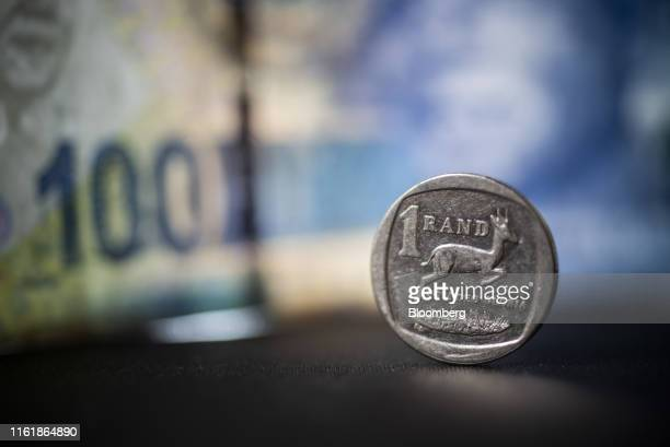 South African one rand coin stands in this arranged photograph in Pretoria, South Africa, on Wednesday, Aug. 14, 2019. The rand ended a tumultuous...