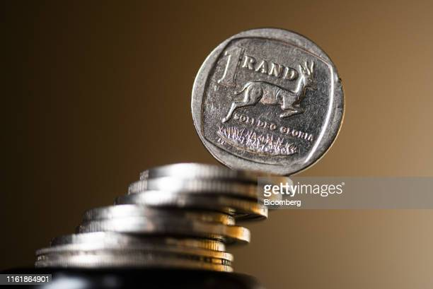 South African one rand coin stands on a stack of coins in this arranged photograph in Pretoria, South Africa, on Wednesday, Aug. 14, 2019. The rand...