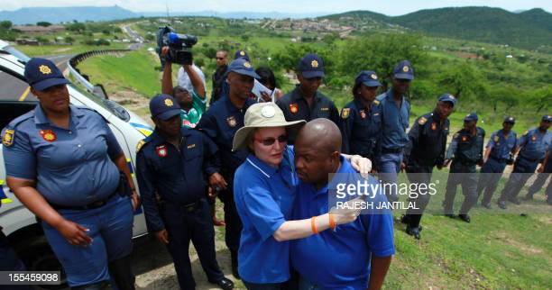 South African opposition leader Hellen Zille is blocked by members of the South African Police Services on her way to to President Jacob Zuma's...