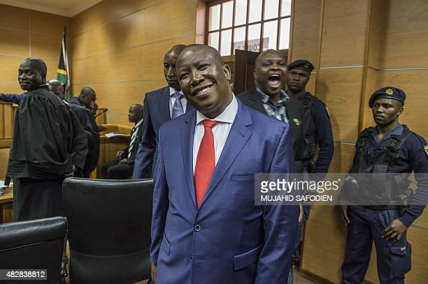 South African opposition party Economic Freedom Fighter leader Julius Malema arrives in the courtroom to stand trial on August 3, 2015 outside the...