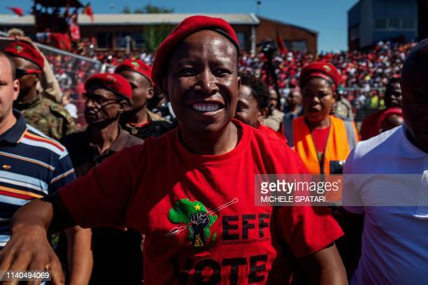 South African opposition party Economic Freedom Fighters leader Julius Malema acknowledges the crowd during a campaign rally held at the Alexandra...