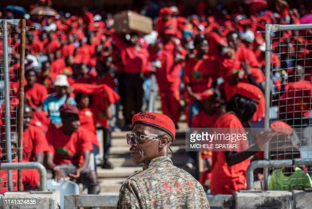 A South African opposition party Economic Freedom Fighters member overlooks the crowd gathered at the Orlando Stadium in Soweto Johannesburg to...
