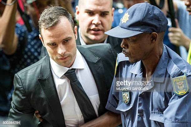 South African paralympian Oscar Pistorius arrives to the Pretoria High court for a bail hearing on December 8 2015 Pistorius appeared in court for a...
