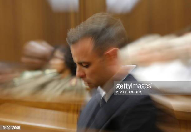 South African Paralympian Oscar Pistorius is pictured inside the dock at the high court in Pretoria, on June 14, 2016 on the second day of South...