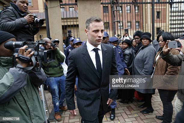South African Paralympian Oscar Pistorius leaves the Pretoria High Court after a sentencing hearing set to send him back to jail for murdering his...