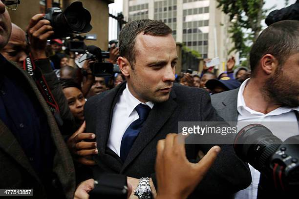 South African paralympic athlete Oscar Pistorius arrives to attend a hearing on the sixth day of his trial for the 2013 murder of his girlfriend on...