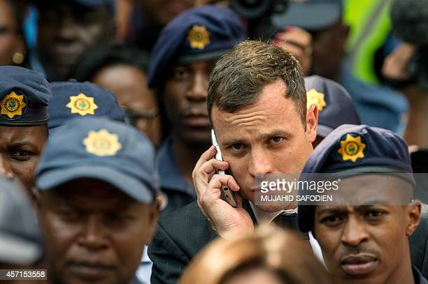 South African Paralympic athlete Oscar Pistorius leaves the Pretoria Hight Court following his sentencing hearing on October 13 2014 Fallen...