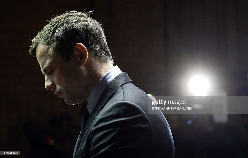 South African Paralympic sprinter Oscar Pistorius appears at the Magistrate Court in Pretoria on August 19, 2013. Pistorius appeared on charges of murdering his model girlfriend Reeva Steenkamp on February 14, Valentine's Day. South African prosecutors will argue that Pistorius is guilty of premeditated murder in Steenkamp's death, a charge which could carry a life sentence. Pistorius denies the charge, saying that he shot 29-year-old Steenkamp repeatedly through a locked bathroom door in the dead of night by accident, having mistaken her for a burglar.