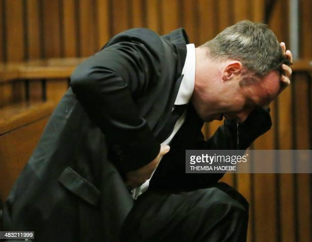 South African Paralympic track star Oscar Pistorius reacts as he listens to evidence by a pathologist during his trial in court in Pretoria on April...