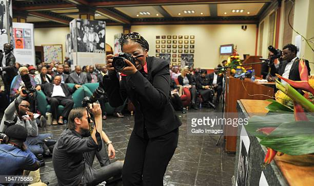 South African photojournalist pay tribute by keeping their cameras' shutters down for 16 sec to salute photographer Alf Kumalo's at his memorial...