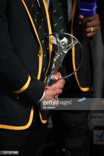 South African player clutches the Laureus World Team of the Year trophy backstage during the 2020 Laureus World Sports Awards at Verti Music Hall on...