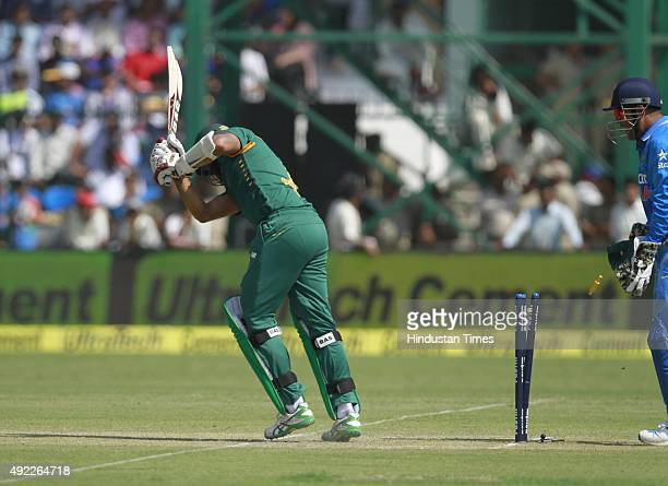 South African player Hashim Amla bowled out by Indian bowler Amit Mishra during the first One Day International match between India vs South Africa...