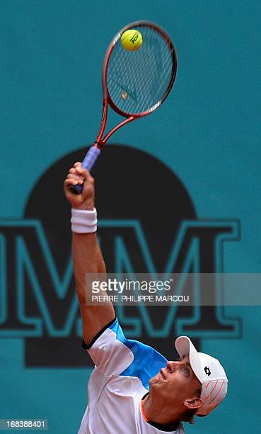 South African player Kevin Anderson returns the ball to Czech player Tomas Berdych during their men's singles third round tennis match at the Madrid...