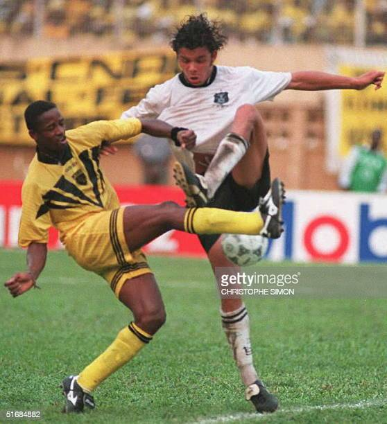 South African player Mark Fish fights for the ball with Ivory Coast player Sekou Bamba during the final match for the African Cup of Champions Clubs...