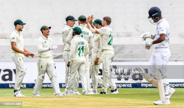 South African players celebrate the dismidssal of Dimuth Karunaratne of Sri Lanka during day 3 of the 2nd Betway Test match between South Africa and...