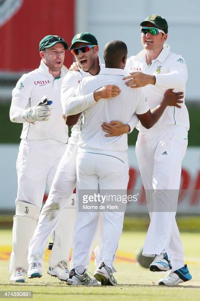 South African players celebrate with Vernon Philander after he got the wicket of Shaun Marsh of Australia during day four of the Second Test match...