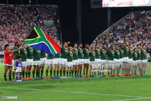 South African players line up for the national anthem prior to the international match between Japan and South Africa at Kumagaya Rugby Stadium on...