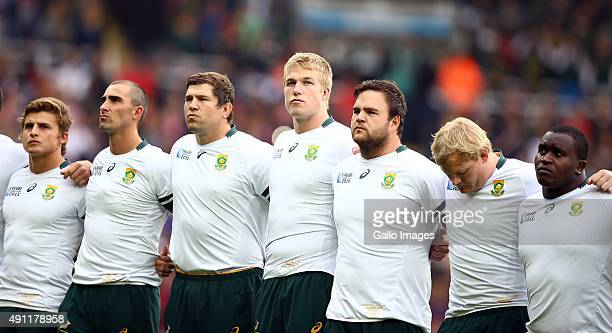 South African players sing the national anthem during the Rugby World Cup 2015 Pool B match between South Africa and Scotland at St James Park on...