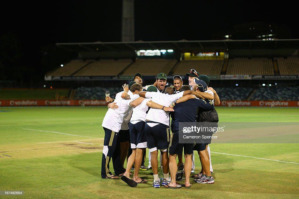 South African players sing together and celebrate on the wicket after defeating Australia and winning the series on day four of the Third Test Match between Australia and South Africa at WACA on December 3, 2012 in Perth, Australia.