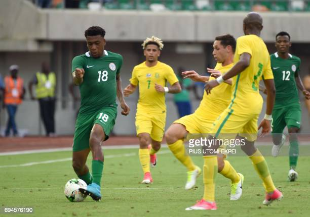 South African players try to stop Nigerian attacker Alex Iwobi from advancing into its half during the 2019 African Cup of Nations qualifyer football...