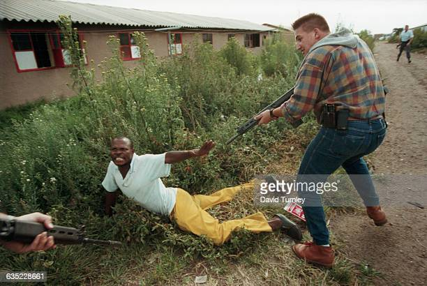 South African police arrest a Zulu man suspected of being a sniper a few weeks before South Africa's free elections of April 1994 Severe conflicts...