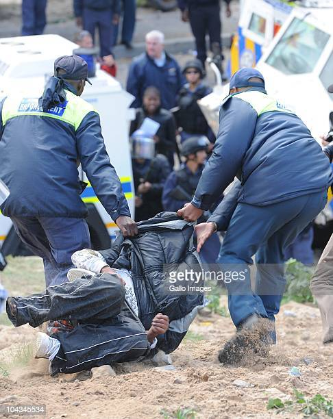 South African police arrest local residents after violence broke out in Hout Bay near Cape Town South Africa on 21 September 2010 when community...