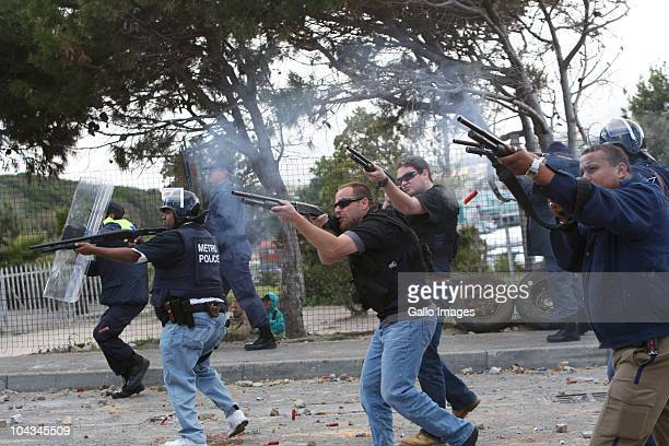 South African police fire rubber bullets at residents of Hangberg after violence broke out in Hout Bay near Cape Town South Africa on 21 September...