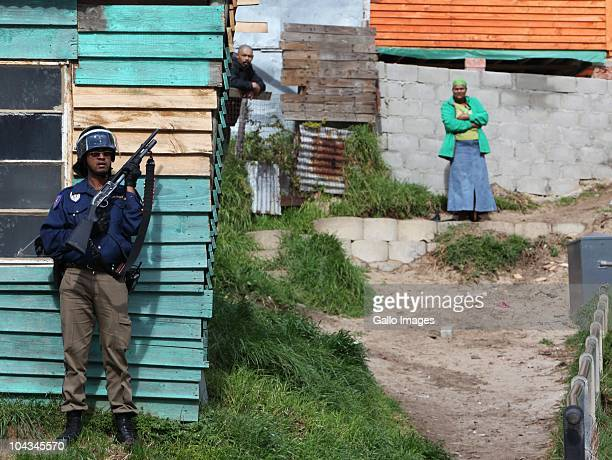 South African police keep watch after violence broke out in Hout Bay near Cape Town South Africa on 21 September 2010 when community members clashed...