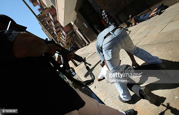 South African police officers stop and search at an illegal bus stop on March 11, 2010 in Johannesburg, South Africa. With 90 days until the start of...