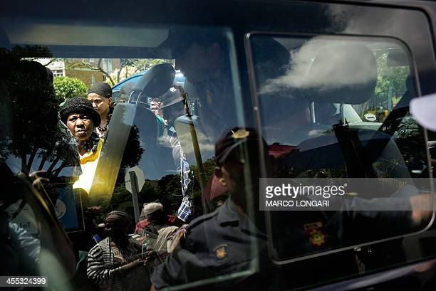 South African police provide access to a van to transport elderly people to the Union Buildings to pay their respect to South African former...