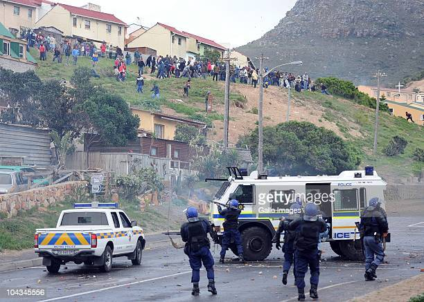South African police shoot rubber bullets at residents of the informal settlement Hangberg after violence broke out in Hout Bay near Cape Town South...