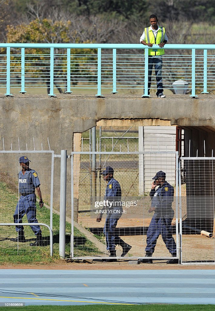 South African policemen patrol around the pitch during a training session of South Korea national football team at Olympia Park Stadium in Rustenburg on June 6, 2010 ahead of the start of the 2010 World Cup football tournament.