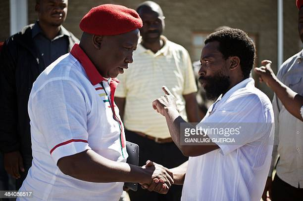 South African political party Economic Freedom Fighters president Julius Malema shakes hand with Buyelekhaya Dalindyebo the king of the Thembu people...