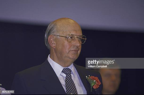 South African Pres Pieter Willem Botha poised with flower in his lapel