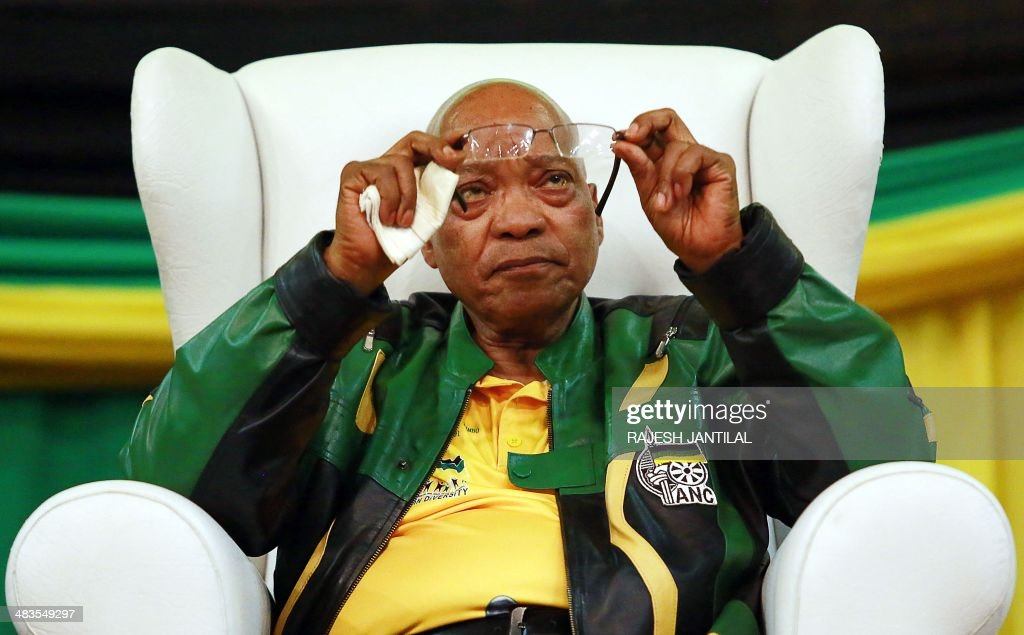 South African President and African National Congress (ANC) President Jacob Zuma cleans his glasses during a campaign event at the Inter-fellowship Church in Wentworth township, outside of Durban, on April 9, 2014, ahead of elections on May 7.