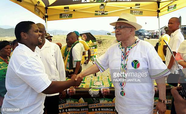 South African president and leader of the ruling African National Congress party Jacob Zuma greets ANC supporters at the Ntolwane Primary School in...
