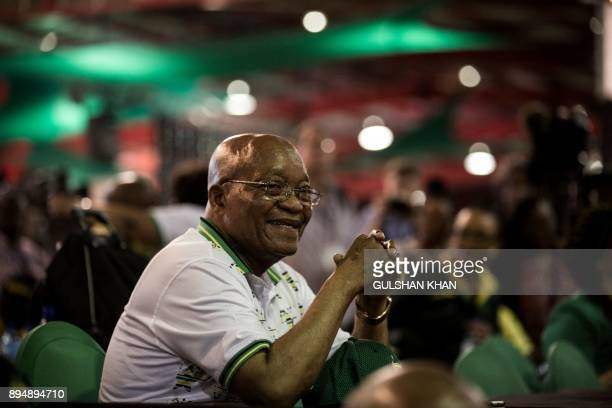 South African President and outgoing President of the African National Congress Jacob Zuma sits with the crowd after South African deputy president...