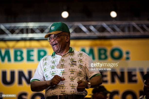 South African President and outgoing President of the African National Congress Jacob Zuma sings on stage before the announcement of the new ANC...
