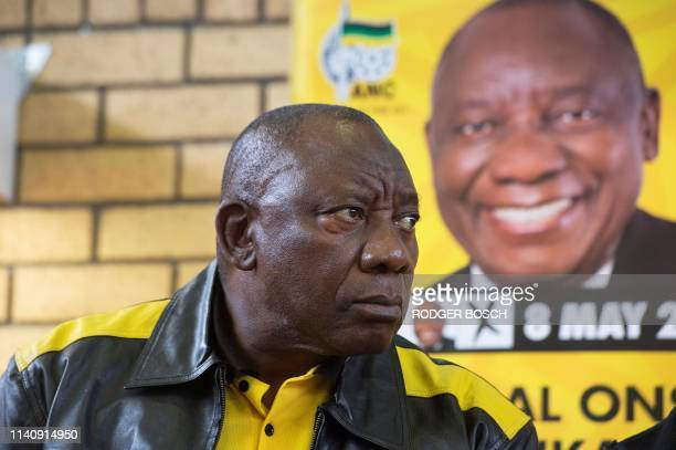 South African President and president of the ruling African National Congress , Cyril Ramaphosa, listens to questions prior to addressing the crowd...