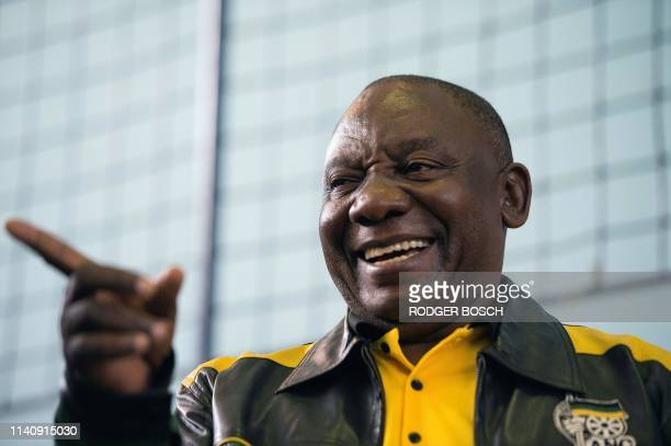 South African President and president of the ruling African National Congress , Cyril Ramaphosa, addresses the crowd during a campaign meeting in...
