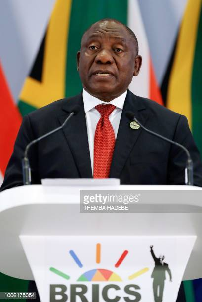 South African President Cyril Ramaphosa addresses a media conference at the end of the BRICS Summit in Johannesburg on July 27 as the heads of the...