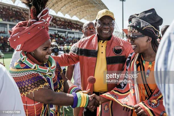 South African President Cyril Ramaphosa and Congress of South African Trade Unions President Zingiswa Losi greet praise singer Jessica Mbangeni at a...